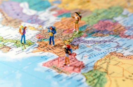 Miniature friends planning euro trip. Macro photo.